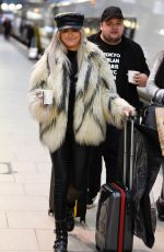 Katie McGlynn Catching an early morning train to London ahead of tonights NTA Awards