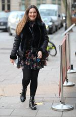 Kelly Brook Makes a leggy appearance in mini dress to Heart Radio in London