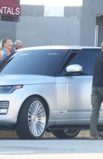 Kim and Khloe Kardashian look very fashionable while filming a new episode of KUWK