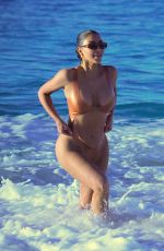 Kim Kardashian In a monokini at the beach in Mexico