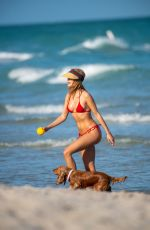 Kimberley Garner Enjoying a day with her dog on the beach in Miami