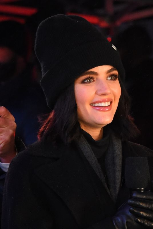 Lucy Hale and Ryan Seacrest are seen filming in Times Square for New Years Celebrations
