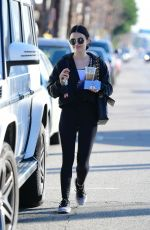 Lucy Hale Seen sharing a coffee with a friend after a workout in Los Angeles