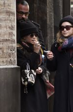 Mary-Kate & Ashley Olsen Take a break to smoke a cigarette outside their office building in New York City