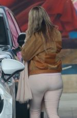Melissa Cohen Displays her growing baby bump while pumping gas in Los Angeles