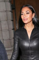 Nicole Scherzinger Wearing a leather catsuit, she steps out officially for the first time in London
