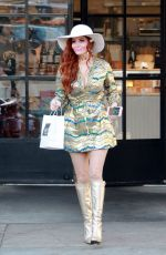 Phoebe Price Poses for pictures while picking up food at Joan
