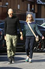 Reese Witherspoon and her husband Jim Toth head to lunch together in Westwood
