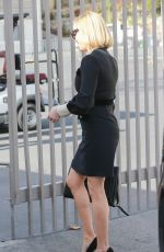 Reese Witherspoon Gets dressed up for a meeting at the Rose Bowl