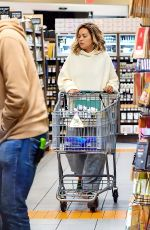 Rita Ora Spotted dressed down in sweats and flip flops while grocery shopping at the Erewhon Market in Los Angeles