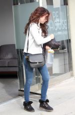 Sarah Hyland Hides behind her long locks while making a quick exit from Shape House day spa in West Hollywood
