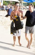 Simon Cowell and Lauren Silverman are pictured at the beach in Barbados