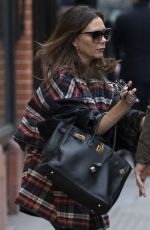 Victoria Beckham Is pictured leaving Tom Davies opticians in Chelsea
