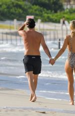 Vogue Williams and Spencer Mattews go for a stroll on the beach in St Barts