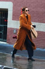 Zoey Deutch Sports a bathrobe style jacket while out shopping in Manhattan