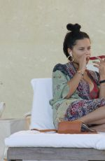 Adriana Lima Shows off her bikini body at the pool in Miami