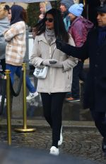 Adriana Lima Steps out with a mystery man for a rainy day in Paris, France