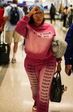 Angela Simmons Spotted in matching pink sweats and sneakers at LAX