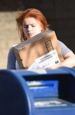 Ariel Winter Handling a package in North Hollywood