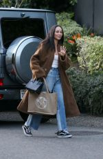 Cara Santana Carrying Protect Your Motion bag going to a friend