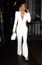 Chloe Sims Gives a busty display while arriving at Bagatelle wearing a white pantsuit in London