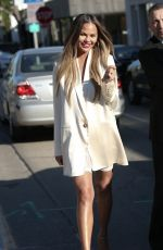 Chrissy Teigen Is sexy in red lipstick and hoop earrings for lunch at Olivetta in West Hollywood