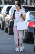 Courteney Cox Wears pink sweatpants while out shopping at The Row women