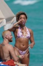 DaniLeigh In a white and pink halter top bikini at the beach with friends, Miami