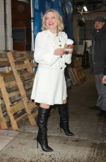 "Elizabeth Moss Looks flawless in a white short dress and black boots while promoting the ""Invisible Man"" in New York"