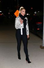 Erika Jayne Rocks a sequin biker jacket and Christian Louboutin boots leaving