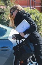 Fergie Looks warm and stylish leaving her son