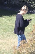 Hailey Bieber Having a chat with a friend at the Bel-Air Country Club in Bel Air