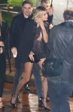 Hailey Bieber Shows off her enviously toned legs arriving at the YSL show in Paris, France