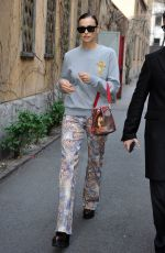 Irina Shayk Holds hands with a mystery man while out during Milan Fashion Week