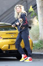 Jessica Hart Steps out for an evening with her puppy in her hands