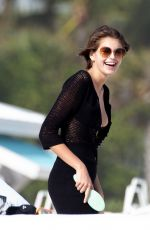 Kaia Gerber Shows off her model assets while enjoying a day at the beach in Miami