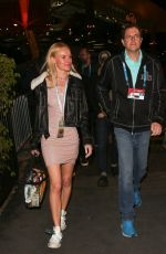 Kate Bosworth Links arms with Jeremy Renner as they leave the 2020 Super Bowl