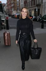 Katie Piper Arriving at BBC studio in a black top and pleated skirt in London