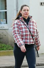 Kelly Brook looks Downcast and Puffy eyed while pictured out and about in London