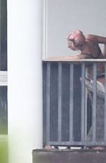 Lady Gaga Enjoys the views from her Miami Balcony in Black Lingerie