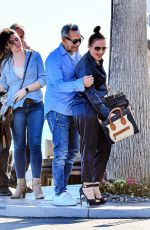 Leah Remini and husband Angelo Pagan were all smiles as they showed some PDA after lunch at Maestros in Malibu