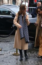 Lily Collins Dons a tan coat and scarf while out in Paris