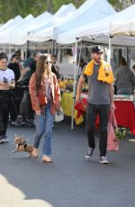 Lily Collins Shows off her new puppy while out with Charlie McDowell