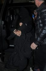 Madonna Walking with a walking cane aid as she is seen arriving at The Palladium London