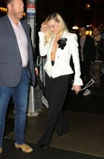Margot Robbie Shows off ample cleavage leaving The Polo Bar in New York