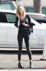 Meghan Edmonds steps out looking extremely happy in LA