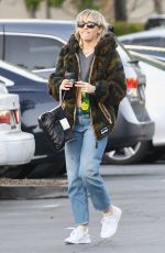 Miley Cyrus Steps out with boyfriend Cody Simpson to pick up sushi in Toluca Lake