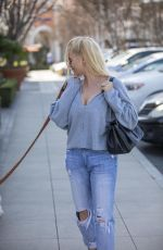 Nicollette Sheridan All smiles while walking her dog in Calabasas