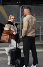Olivia Buckland and Alex Bowen pictured while arriving at the Manchester Piccadilly Train Station in Manchester