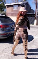 Phoebe Price Poses in an animal print ensemble in West Hollywood